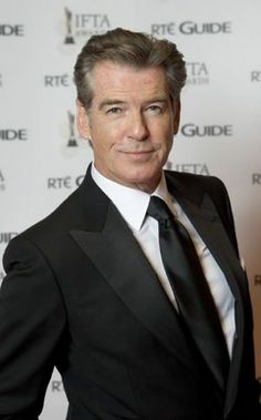 for - is Christian's father. He is tall, blonde with blue eyes. Blonde With Blue Eyes, Pierce Brosnan, Fifty Shades Of Grey, Christianity, Suit Jacket, Fictional Characters, Father, Pai, Jacket