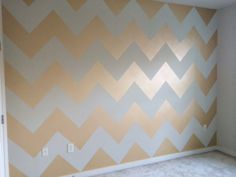 Metallic gold chevron wall using Benjamin Moore Studio Finishes Metallic Glaze paint