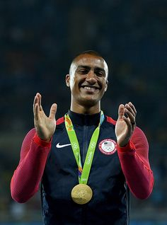 Gold medalist Ashton Eaton of the United States poses on the podium during the…