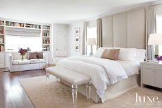 In the master bedroom, Berg created a cocoon-like feeling with a floor-to-ceiling upholstered headboard and draperies.