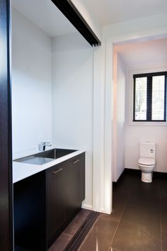 Still on the ground floor a laundry cupboard and separate toilet are positioned alongside the internal access garage.