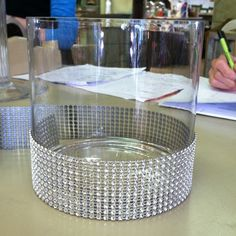glass vase w/ detail wrap to add sparkle....centerpiece idea?