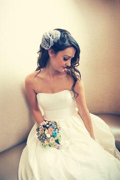 Love everything about this bride. Photo by Heidi. #weddingphotographersMN #broachbouquet #weddinghair
