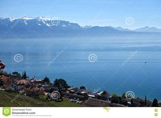 Photo about A scenic expanse from vineyards of Switzerland looking out on Lake Leman towards the French Alps. Image of peaks, lake, alps - 70998483 French Alps, Switzerland, Sailing, Stock Photos, Mountains, Travel, Image, Candle, Viajes