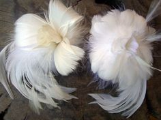 These gorgeous goose and ostrich feather flowers would look great as a hair or hat accent.