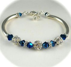 Blue Swaroski beads and silver bracelet.