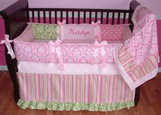 "Ava Baby Bedding  This custom baby bedding set includes the bumper, blanket, and pleated border crib skirt. The stripes, polka dots, cartwheel swirls, and damask make this a truly unique bedding set for those parents who are not ""off the shelf"" mommies and daddies.  The multiple shades of pink and green are easy to coordinate with any nursery."
