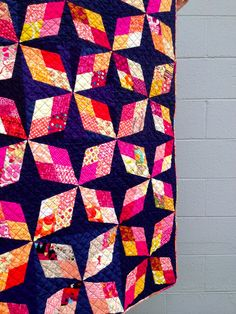 Bright pink, Yellow, Orange, and Red Prints on a Solid Dark Background - do. Good Stitches: Arkansas Traveler Quilt