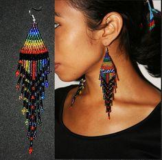 Sparkling Rainbow Earrings, Seed Bead Earrings, Dangling Gypsy Earrings, Native American Beaded Earrings, Huichol Bead Work, Tribal, Festive by BiuluArtisanBoutique on Etsy https://www.etsy.com/listing/260651741/sparkling-rainbow-earrings-seed-bead