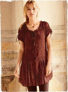 This is listed as a dress, but I like it as a tunic top.