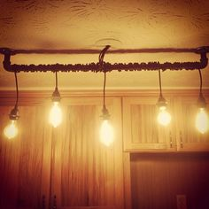 DIY rustic home track lighting for kitchen made with blackened steel  with  exposed sockets andtrack lighting with pendant general lights  plank floor leads to  . Diy Kitchen Track Lighting. Home Design Ideas