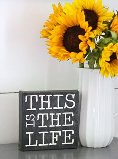 Sunflowers in a white pitcher vase for the Dining room, instead of the pink and yellow tulips in the picture. A little splash of Kansas.