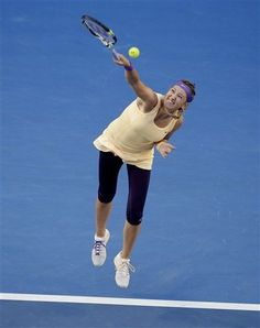 Victoria Azarenka of Belarus serves to China's Li Na during the women's final at the Australian Open tennis championship in Melbourne, Australia, Saturday, Jan. 26, 2013. (AP Photo/Rob Griffith)