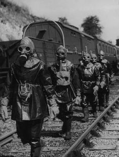 A breakdown squad on a training exercise to rerail a carriage under conditions of a poison gas attack on the Southern Railway, England, 1st September 1943.