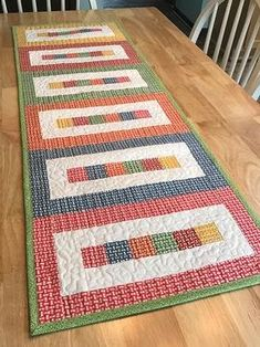 Use these pieced table quilt patterns to add a beautiful finishing touch to your table. Table quilts make great table runners, candle mats, and more.Pieced Table Topper Patterns - This runner is easy enough for a beginner, but fun for anyone who need Patchwork Table Runner, Table Runner And Placemats, Quilted Table Runners, Fall Table Runner, Quilted Table Runner Patterns, 10 Minute Table Runner, Quilt Placemats, Modern Table Runners, Table Topper Patterns