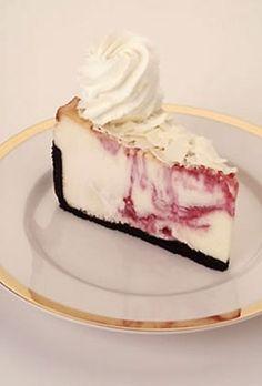 White Chocolate Raspberry Truffle Cheesecake. Copy cat recipe at: http://sewhooked.com/2009/02/28/recipe-review-white-chocolate-raspberry-truffle-cheesecake/