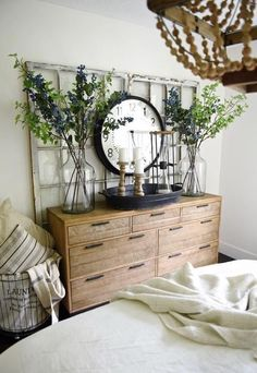 ✨ Vintage-styled Wooden Storage Unit with Chest of Drawers, 🍀 Flower Vase on either side of 🕐 Wall clock, Candle Stand on the Storage Unit - GharPedia Rustic Bedroom Design, Farmhouse Master Bedroom, Master Bedroom Makeover, Bedroom Furniture Design, Wood Bedroom, Master Bedroom Design, Bedroom Ideas, Furniture Ideas, Furniture Websites