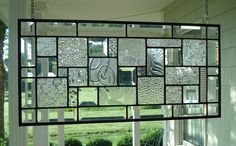 Stained Glass Window Panel Clear Textures and Bevels  Made To Order Please Allow 4 Weeks  Size: 21 3/8 x 10 3/8  This stained glass panel was