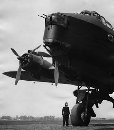 Pilot Joan Hughes is dwarfed by a Short Stirling