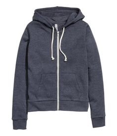 Sweatshirt jacket with a lined drawstring hood. Zip and pockets at front. Brushed inside.