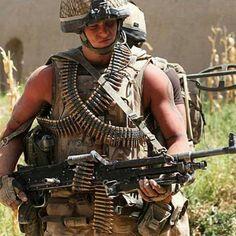 A British Army 2 Para machine gunner with medium machine gun on patrol in Afghanistan.