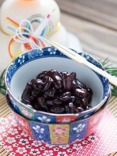 "Kuromame (Sweetened Black Beans) | Chopstick Chronicles Kuromame (meaning ""black beans"" in Japanese) are tasty, sweetened black soybeans that are usually eaten as part of the Japanese New Year's celebration food (Osechi Ryori). These beans are soaked and simmered in water for a long time, which can be quite annoying to wait for, but it's definitely worth it because once they're cooked they're so soft and so delicious! These beans are said to represent health and hard work, which is why they…"