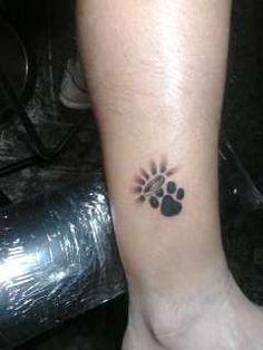 Paw memorial tattoo