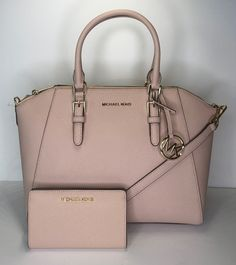 Michael Kors Ciara Shoulder and Slim Bifold Set Ballet Leather Satchel. Save big on the Michael Kors Ciara Shoulder and Slim Bifold Set Ballet Leather Satchel! This satchel is a top 10 member favorite on Tradesy. See how much you can save. Carteras Michael Kors, Sac Michael Kors, Michael Kors Shoulder Bag, Handbags Michael Kors, Michael Khors, Luxury Purses, Luxury Bags, Luxury Handbags, Designer Handbags