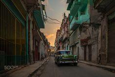 Green classic, Havana - Classic green car driving through the old city of Havana