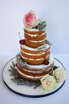 Naked wedding cake with real flowers and cherries.