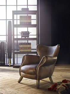 Inspired by the traditional armchairs found in English universities. The Scholar chair has generously curved lines, modern wingtips and distinctive hand-applied brass studding. A favourite chair for strategic thinking or to sit and debate the day.