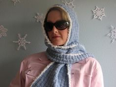 Mom wants a hooded scarf. I searched all over before I found this one from verypink.com. I'm doing it in black to match all her winter coats, and I'm not very far along yet, but I think it will be quite nice.