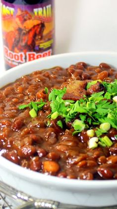 Sweet Root Beer Baked Beans in a Crock Pot  Super EASY Made in a Crock Pot Slow Cooker, these Baked Beans are just a little spicy, but wrapped in a Sweet Toot Beer reduction thick, rich gravy.  I had this at a big BBQ with lots of kids and family.  Was a HUGE hit.  Sweet enough that the kids gobbled 'em and so filled with flavors the Dads went crazy for 'em.  A CROWD PLEASER!!! Crockpot Dishes, Crock Pot Slow Cooker, Crock Pot Cooking, Slow Cooker Recipes, Crockpot Recipes, Cooking Recipes, Bean Recipes, Side Dish Recipes, Side Dishes