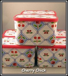 International coffee tins covered with cute little cherry Mary Engelbreit contact paper. Cute storage