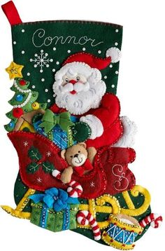 Santa fills his sleigh with toys in the Santa's sleigh felt Christmas stocking kit by Bucilla. Felt Stocking Kit, Christmas Stocking Kits, Felt Christmas Stockings, Christmas Ribbon, Vintage Christmas Ornaments, Christmas Wreaths, Christmas Crafts, Christmas Decorations, Stocking Ideas