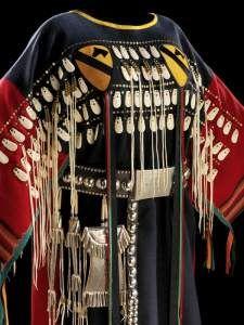 Woman's Battle Dress, worn by female relatives of warriors of the Ton-Kon-Ga (Kiowa Black Leggings Society). Made by Vanessa Paukeigope Jennings ( Kiowa-Apache-Gila River Pima)