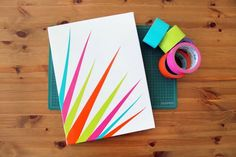 Create your own DIY colorful wall art in minutes using colored duct tape, canvas, and an X-ACTO knife. (via Brit + Co) #homedecor #diyproject