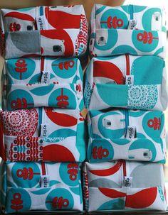 Adorable zipper bags from Apple Cyder using Laurie Wisbrun's Brrr! fabric from Robert Kaufman.