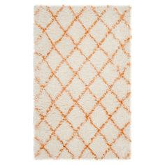 Lend a touch of textured appeal to your living room or master suite with this elegantly loomed shag rug, showcasing a timeless lattice motif for classic styl...