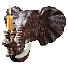 Bring adventuresome appeal to your dining room or library with this elephant-inspired candle sconce, showcasing ornate hand-painted details.    ...