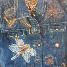 Such a whimsical jean jacket with a garden of delightful flowers, butterflies and dragonflies embroidered on it with beaded accents. Sunlike buttons too!