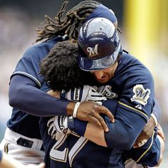 MLB Official Facebook Carlos Gomez and Rickie Weeks hug Jonathan Lucroy after his walk-off suicide squeeze ...
