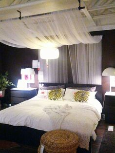 Bedroom with black and white comforter, yellow accents, red ...
