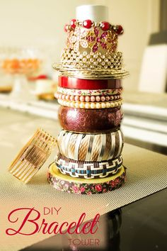 Decorista Chronicles-DIY Bracelet Tower!)  I just use an empty glass root beer bottle for mine