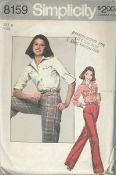 An original ca. 1977 Simplicity Pattern 8159.  Juniors and Misses Shirt and Pants: Top-stitched shirt with front band button closing and collar has flaps buttoned to pleated pockets, shirt-tail hem, long set-in sleeves with buttoned cuffs and optional buttoned sleeve and shoulder tabs. Top-stitched pants with fly front zipper and pleats have side pockets, waistband with self carriers and optional button trimmed flap.