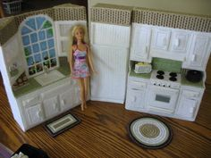 Deluxe kitchen for Barbie size dolls. Made from plastic canvas and yarn,