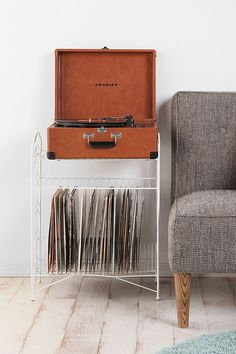 White Record Stand at Urban Outfitters Record Player Stand, Record Rack, Record Holder, Vinyl Record Storage Shelf, Storage Shelves, Storage Ideas, Magazine Deco, Wire Storage, Basket Storage