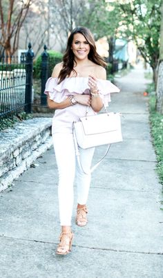 Blush off the shoulder ruffle satin top+white skinny jeans+camel lace-up heeled sandals+white handbag+gold necklace+bracelets+watch. Summer Casual Outfit 2017