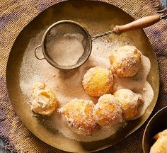 Cinnamon puffs with dulce de leche: These sweet, spiced doughnuts were made for dunking in the thick, rich caramel sauce.