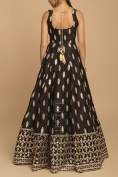 Black Gota Patti Anarkali Black Gota Patti Anarkali Price: INR Black is back and how! Radiant gotapatti romances black in the most flattering outfit from our collection. Black gotawork anarkali with sheer, net dupatta. Indian Gowns Dresses, Indian Fashion Dresses, Indian Designer Outfits, Indian Outfits, Fashion Outfits, Fashion Weeks, Indian Designers, Designer Party Wear Dresses, Kurti Designs Party Wear